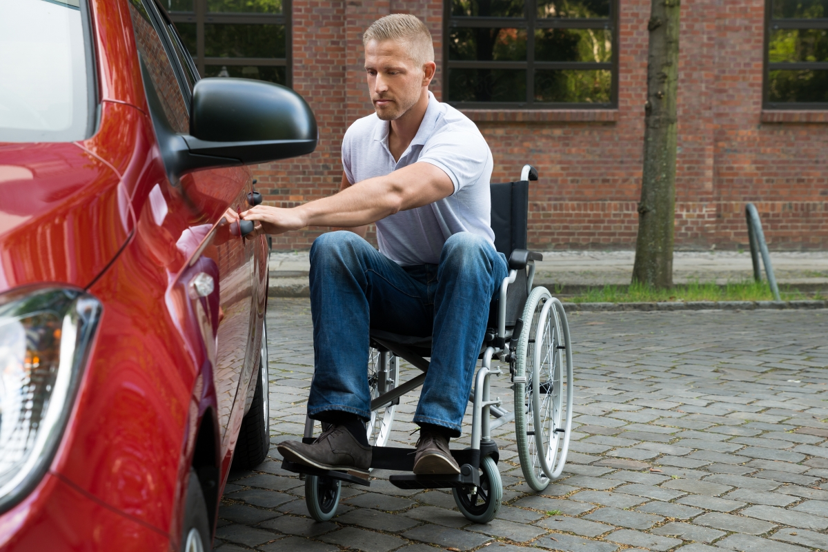 Handicapped Man Opening Door Of A Car